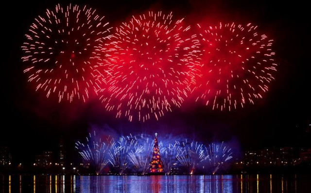 Fireworks explode over a giant floating Christmas tree in Lagoa lake at the annual tree lighting event in Rio de Janeiro, Brazil