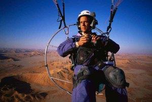 Photographer George Steinmetz captures an image of himself piloting a motorised paraglider over Shibam, Yemen.