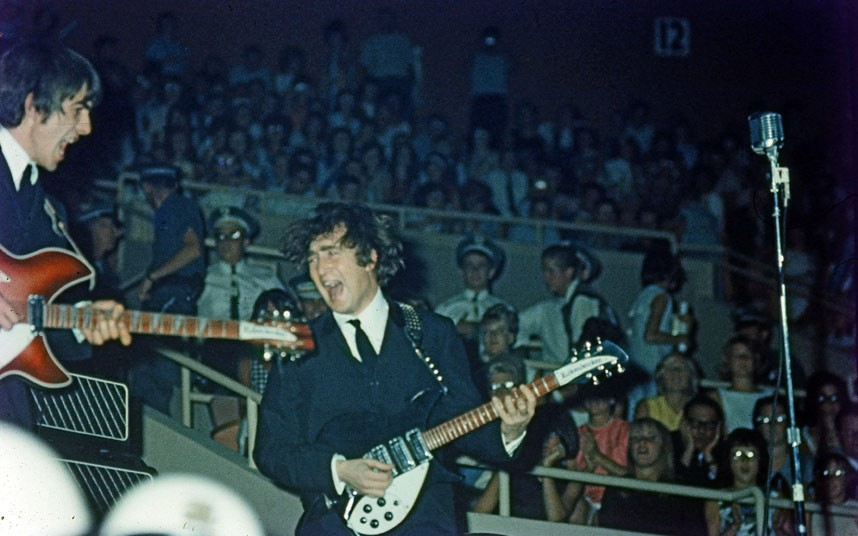 George Harrison with his red Rickenbacker, first used in the film A Hard Day's Night